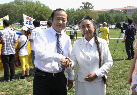 Wang, Jun and Rabiye Qadir, Uighur human rights activist in the Falun Gong rally